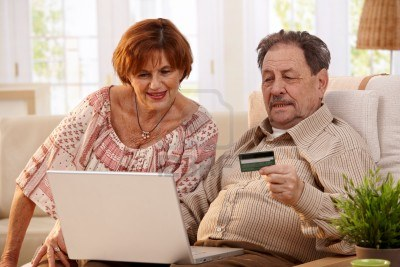 7136687-elderly-couple-shopping-online-at-home-using-laptop-computer-and-credit-card (400x267, 30Kb)