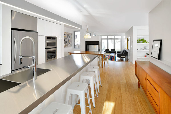 modern-white-kitchen-long-stainless-steel-worktop-wooden-accents (600x401, 148Kb)