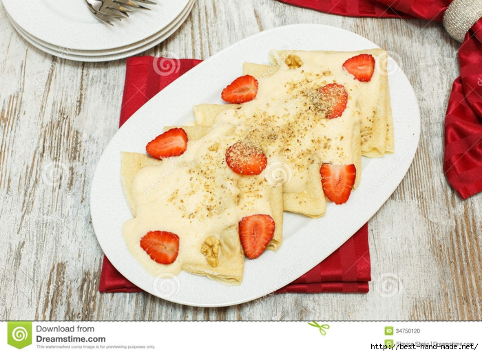 crepes-honey-strawberries-walnuts-pancakes-christmas-berries-pastry-forms-fir-tree-festive-table-viewed-above-34750120 (700x515, 319Kb)
