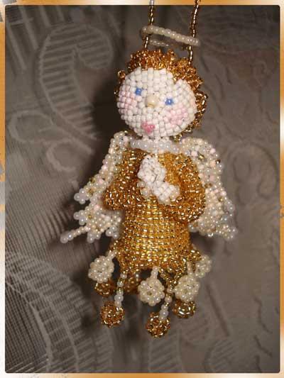 """Сувенирная игрушка из бисера  """"Кукла тряпичная """" ."""