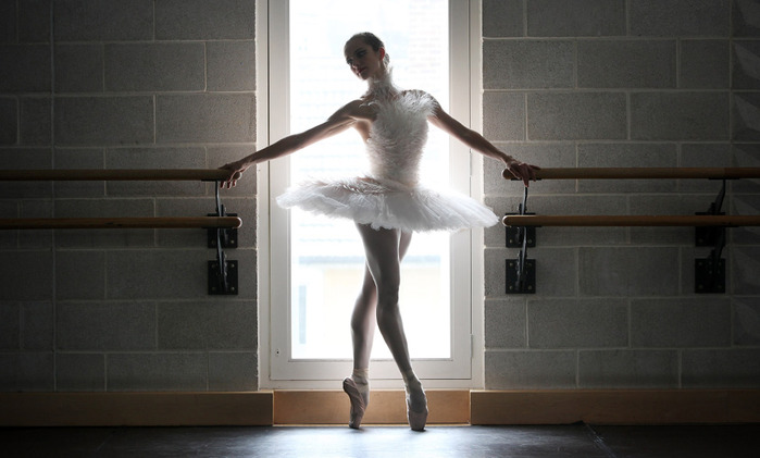 A dancer from the English National Ballet performing 'Ballets Russes' at Sadler's Wells poses in her 'Dying Swan' costume designed by Karl Largerfeld on June 16, 2009 in London, England. (Oli Scarff/Getty Images)