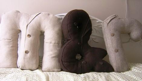 Например, такого материала...  Подушки-буквы из старых пиджаков.