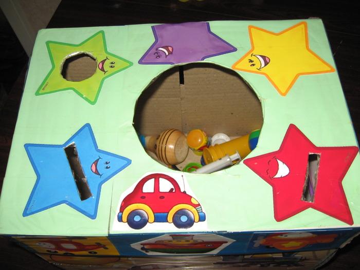 Развивающие игрушки своими руками из коробки и крышек