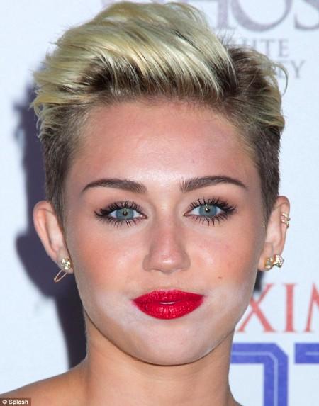 115302947_MileyCyruswhitepowderface450x5
