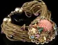(196x155, 61Kb)Золото 585 пробы, желтый сплав, 2 бриллианта Кр57 0,02 ct (3/3), эмаль, кварц, коралл, шпинель. При изготовлении браслета использовались нити, сплетенные из золотой паутинки