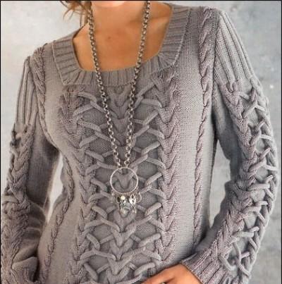 Модный джемпер с косами и жгутами вязаный спицами.  Описание вязания, схемы, выкройки.  Прочитать целикомВ.