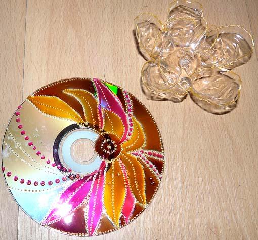 Бабочка из дисков сделать своими руками