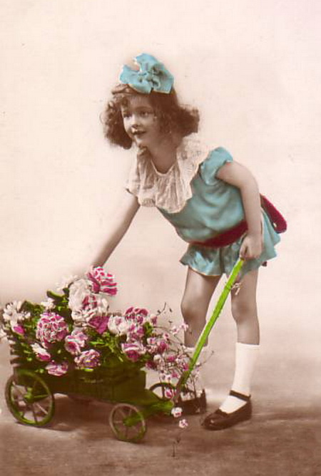 Picture-Postcard-cute-little-girl-in-short-blue-dress-with-wheel-cart-full-of-flowers.gif (450x668, 77Kb)