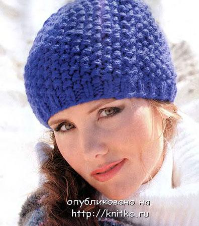 Синяя шапочка связанная спицами.  Такая форма шапочки подчеркивает овал лица и отлично гармонирует с объемной верхней...