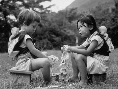 John Dominis' American Child Playing with Chinese Friend, Washing Doll Clothes