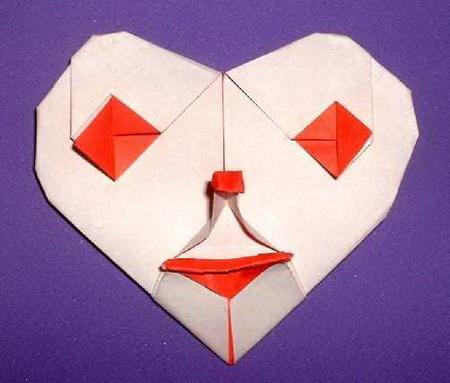 сердце оригами из бумаги,как сделать сердце оригами,оригами сердечко из бумаги,бумажные сердечки,идеи ко дню святого валентина/4395419_origami_heart2 (450x383, 52Kb)