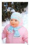 Комплект (шапка с ушками и шарф) для малышки связан спицами.