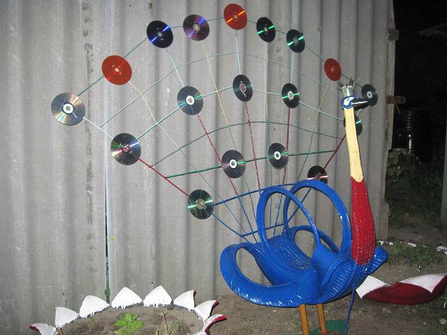 Как сделать павлина из дисков пошаговая инструкция