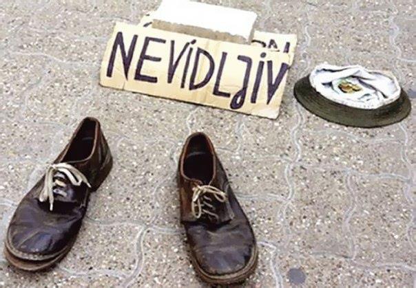 На улицах Сербии появился преуспевающий нищий-невидимка (604x419, 54Kb)