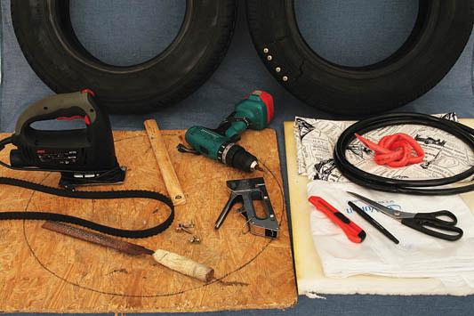 ...шурупы. ткань. степлер. шуруповерт. лист ДСП или фанеры. ремень. шланг. нож. лобзик. две старые шины. маркер.