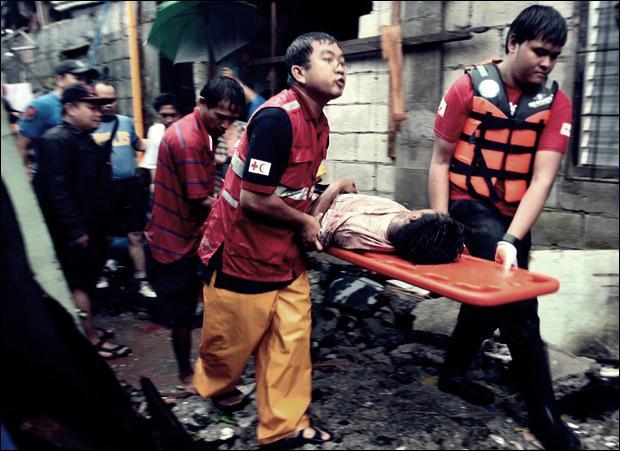 Наводнение на Филиппинах. Фотографии затопленной столицы Манилы 13 (620x451, 53Kb)