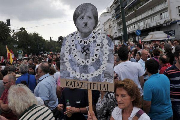 Массовые протесты против визита Ангелы Меркель