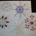 Например, можно...  Плетение снежинок из бисера и стекляруса.