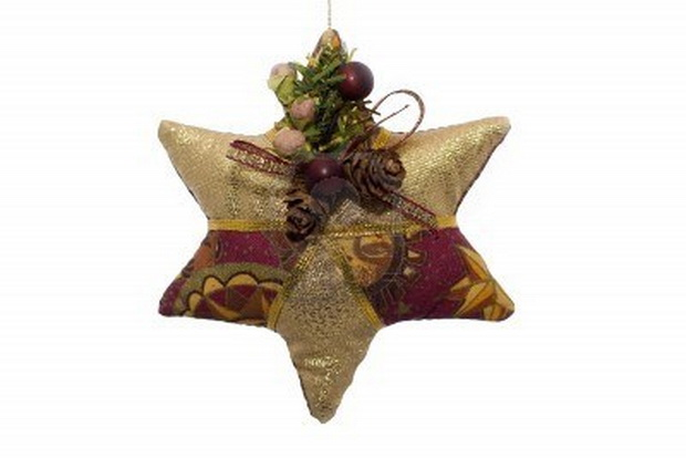 1789730-a-fabric-christmas-ornament-shaped-like-a-star-on-a-white-background (620x414, 47Kb)