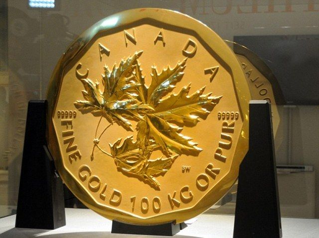 деньги Самая большая монета (640x477, 54Kb)