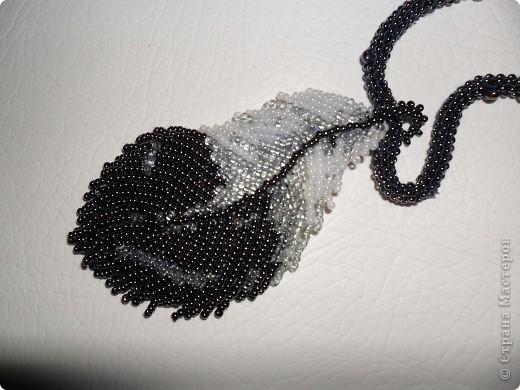 1.Перо Финиста-ясного орла.2.Еще одна вышивка.  Временно отложила плетение бисером,учусь им вышивать.