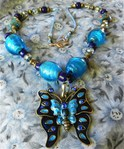 Превью enameled_blue_butterfly_large_pendant_foil_lined_glass_beaded_necklace_a6d7f4b0 (415x500, 86Kb)