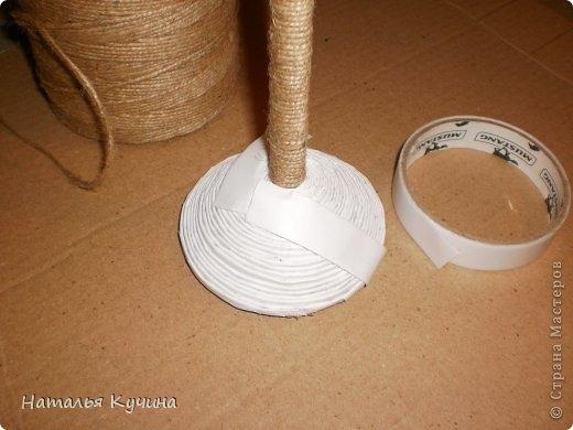 Подставка для елочки из джута и газетных трубочек (11) (520x390, 94Kb)