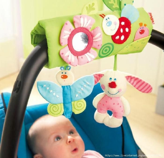 Тележка с мотоИгрушка для новорожденного в кроватку