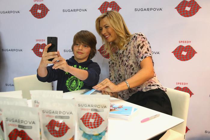 Maria+Sharapova+Maria+Sharapova+Loves+Porsche+XbosNFSZ6onx (700x466, 93Kb)