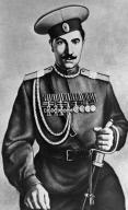 Рис.2.1.7.9 Буденный. Летом 1917 г. принимал участие в издевательствах над Членами Семьи Императора. Присвоил себе чужие Георгиевские кресты (117x192, 20Kb)