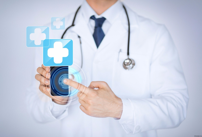 photodune-5113032-doctor-holding-smartphone-with-medical-app-m (700x475, 203Kb)