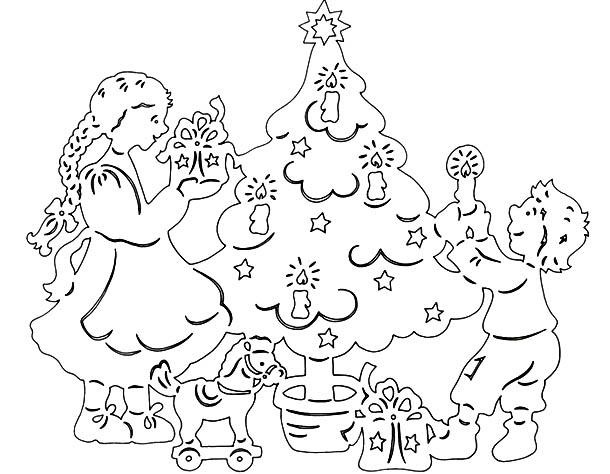 вырезать новогодние рисунки на окно