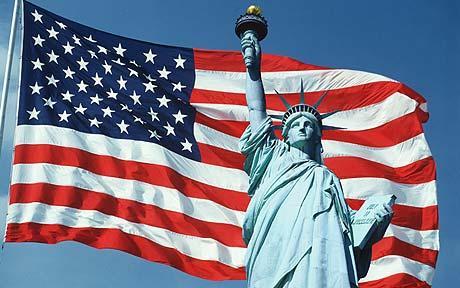 Статуя Свободы с факелом в руках на фоне американского флага/3241858_unitedstates (460x288, 32Kb)