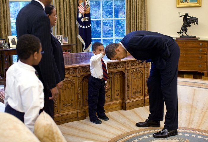 #3 A Young Boy Reaches Up To Compare The President's Hair To His Own.