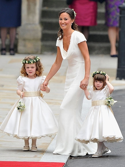 LONDON, ENGLAND - APRIL 29:  Sister of the bride and Maid of Honour Pippa Middleton holds hands with Grace Van Cutsem and Eliza Lopes as they arrive to attend the Royal Wedding of Prince William to Catherine Middleton at Westminster Abbey on April 29, 201