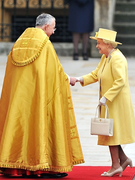 LONDON, ENGLAND - APRIL 29:  Queen Elizabeth II is greeted by The Right Reverend Dr John Hall, Dean of Westminster as she arrives to attend the Royal Wedding of Prince William to Catherine Middleton at Westminster Abbey on April 29, 2011 in London, Englan