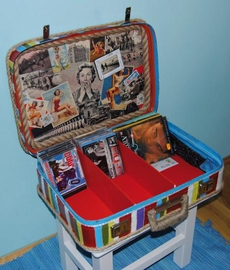И... Нашли старый чемодан, сделали внутри каркас с перегородками, по размерам CD и DVD дисков (замеряли...