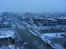 [+] Увеличить - Израненные в боях Хомс в снегу. @RamiAlLolah