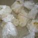 4. В кипящую воду опустить мешочки с яйцами и варить до готовности.
