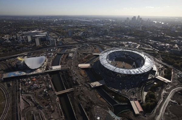 The Olympic Stadium and Aquatics Centre (L) are seen under construction in a south facing aerial view looking towards Canary Wharf in London November 11, 2010. The Olympic Games are to be held in London from July 27 to August 12, 2010. Picture taken Novem