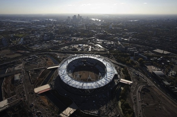 The Olympic Stadium is seen under construction in a south facing aerial view looking towards Canary Wharf in London November 11, 2010. The Olympic Games are to be held in London from July 27 to August 12, 2010. Picture taken November 11, 2010. REUTERS/Ant