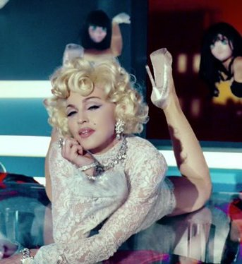 madonna-give-me-all-your-lovin-video5-1328262170-view-0 (343x374, 28Kb)