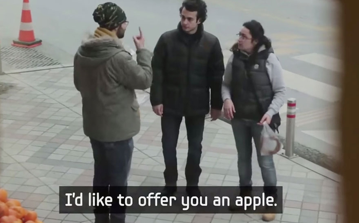 town-learns-sign-language-deaf-muharrem-samsung-video-call-center-14 (700x435, 144Kb)