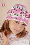 30844. Детская шапочка связанная крючком, украшена атласной летной и...