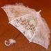 На 4 месте просто красавчеГ зонт с огромным бантом с боку и выполненным...